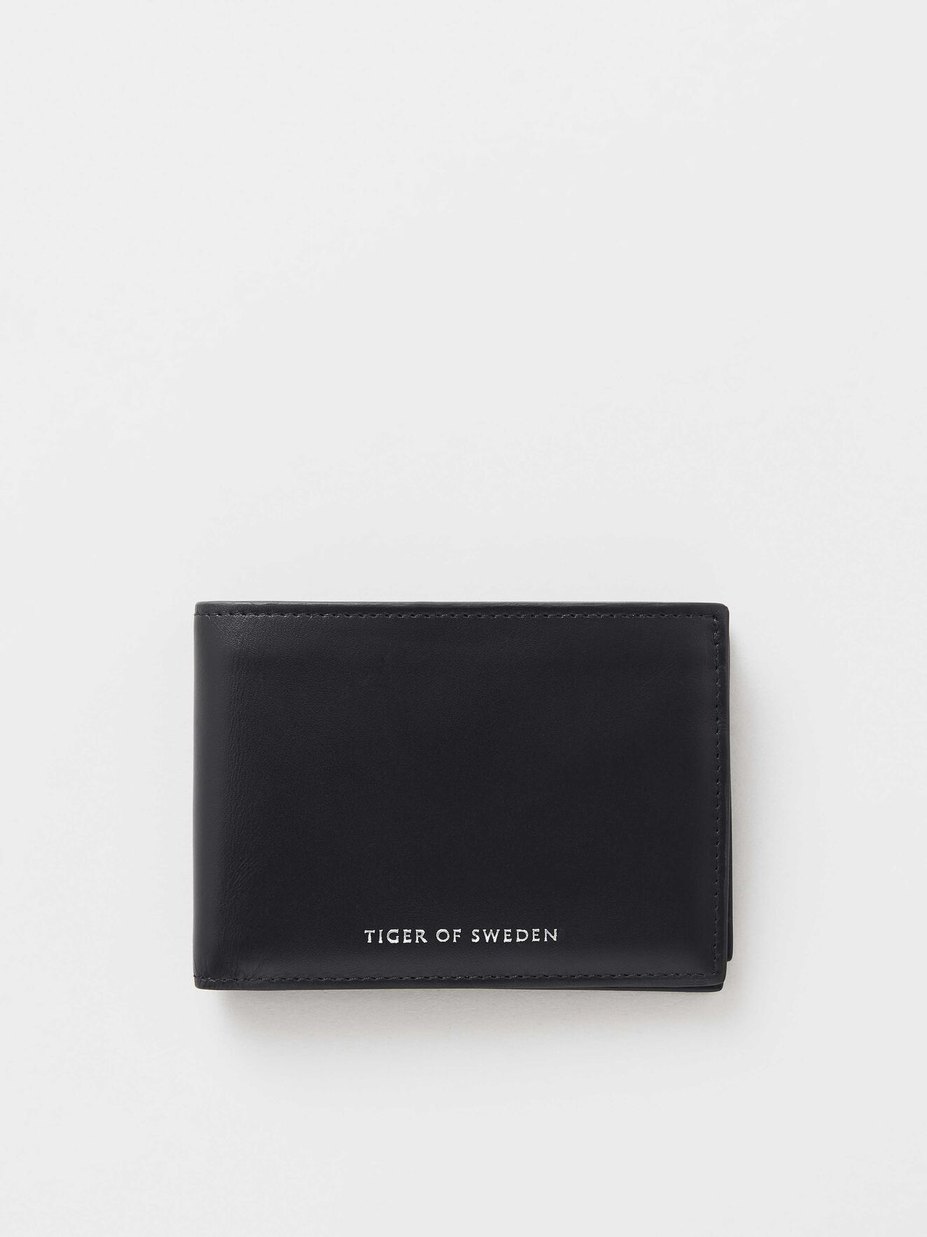3dea9128a0c46 Wallets - Buy leather designer wallets online at Tiger of Sweden